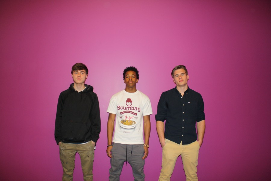 Muralists stand in front of where the upcoming mural will be, stairwell A. (Left to right, Aiden Piper, Julian Guyton and Mason Maj)