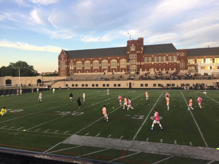 The Boys Varsity Soccer team warmed up with a scrimmage before the game