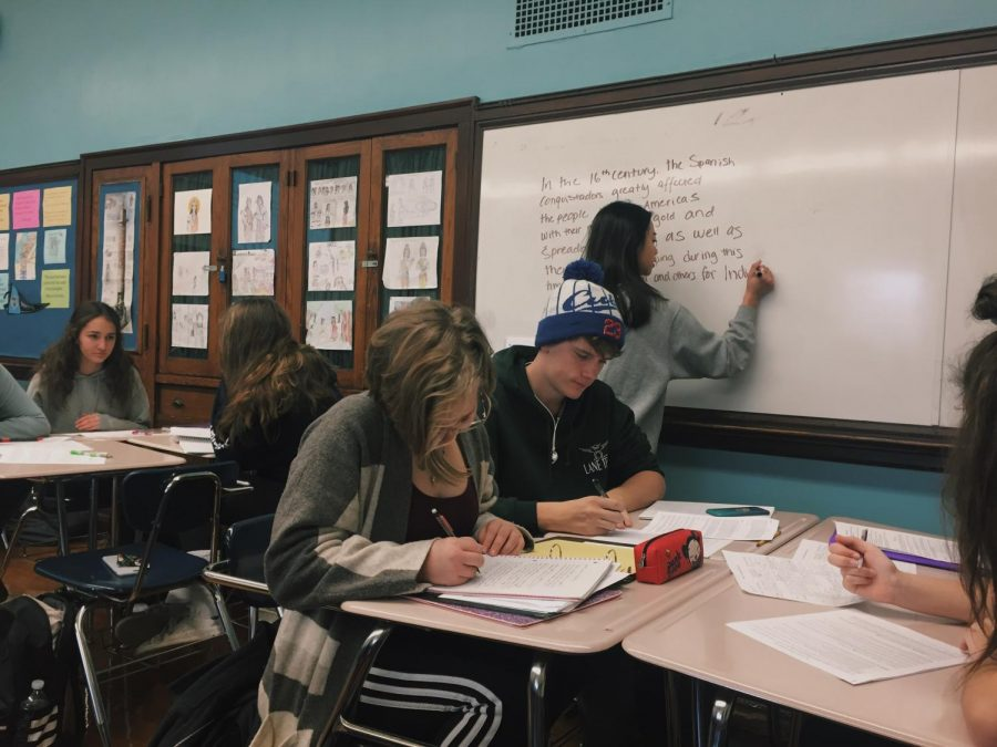 Students in AP World work on DBQ (Document Based Question) thesis statements in groups to prepare for the AP exam.