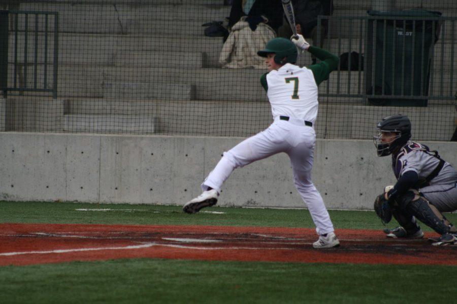 Senior starting second baseman Aaron Gerber hits an RBI single against New Trier to tie the game in the bottom of the fifth. The Indians lost the lead late in a 3-2 defeat on March 20.
