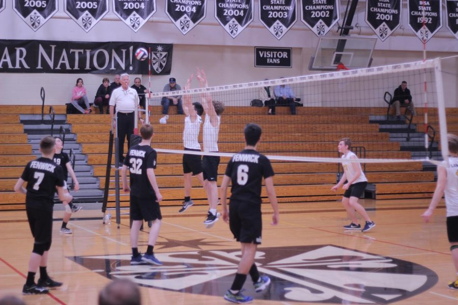 On March 20, the Boys Volleyball team first faced Fenwick at the start of their season beating them in two sets 25-14, 25-21. Photo courtesy of Sophie Smith.