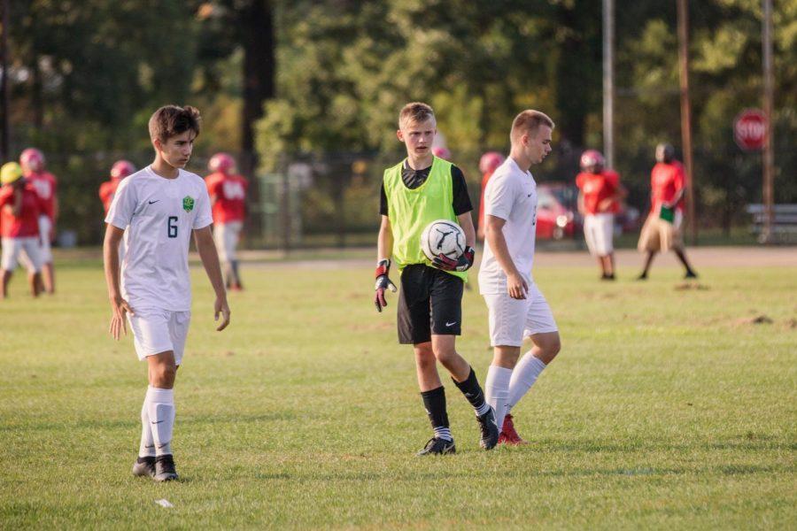 Jacob Bozek, Div. 080, and his twin Matthew Bozek, Div. 081, playing soccer together for the Lane soccer team. (Photo courtesy of Jacob Bozek)