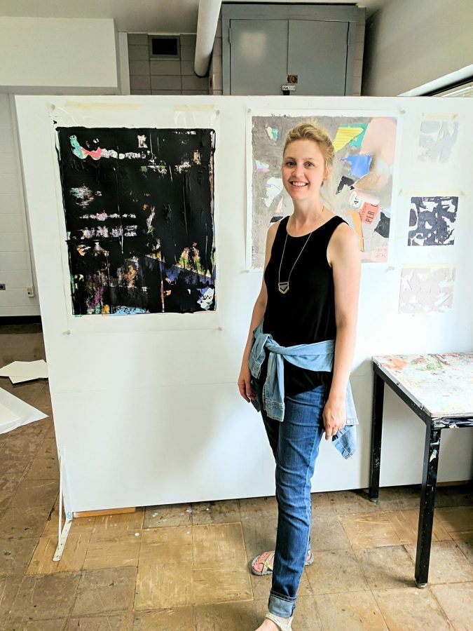 """Ms. Wain posing with her artwork at a micro-residency at the University of Illinois at Urbana-Champaign, which she and the other art teacher refer to as """"Art Camp"""". (Photo courtesy of Ms. Wain)"""
