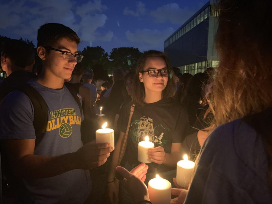 """Lane students gathered at the vigil holding candles in support of Greta Pearl, who was involved in a car accident  on Aug. 12. """"There is so much strength here tonight,"""" Katie Bermingham Snyder, a close friend of the Pearl family, said. """"We need everyone to take all that strength and send it to Greta."""""""