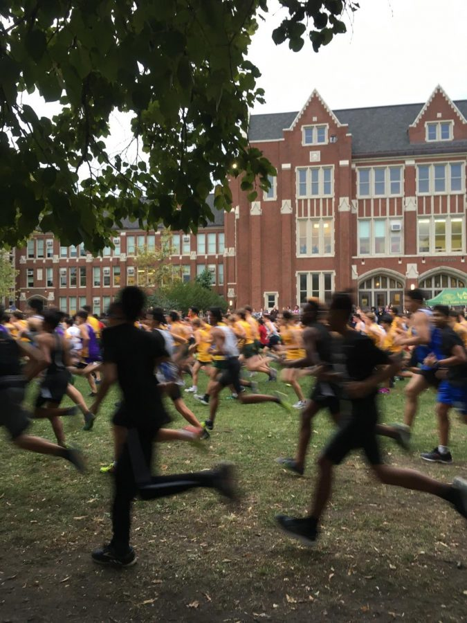 Boys Cross Country runs past the starting line at their last Lane Meet.