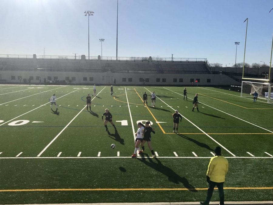 Girls Soccer players from Lane (black) and Jones (white) fight for control of the ball.