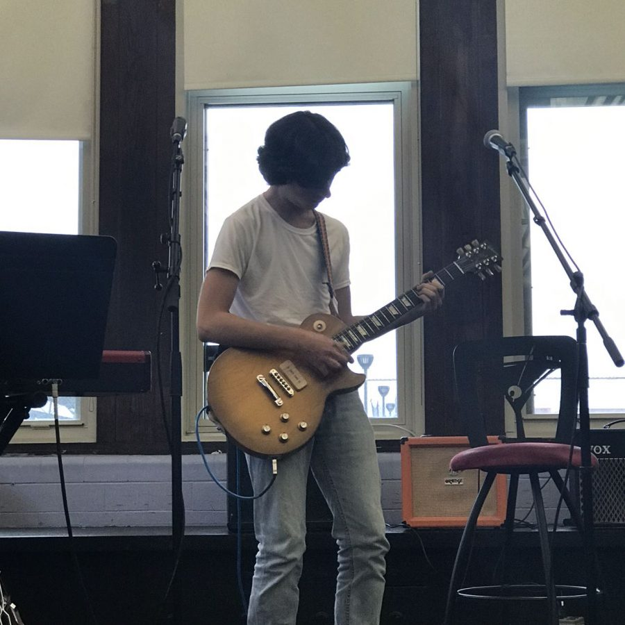 Henry Chmielewski, Div. 165, performs a guitar solo at the Oct. 10 open mic.