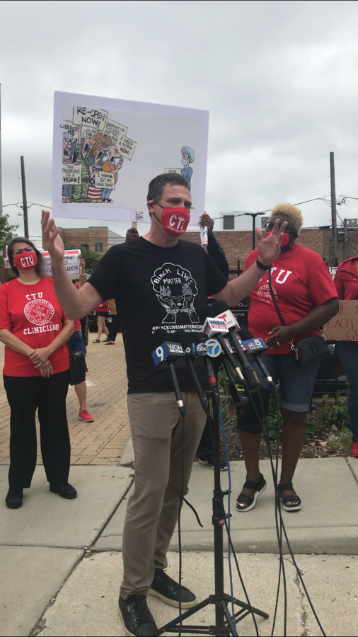 CTU President Jesse Sharkey addresses a crowd at the CTU headquarters at an Aug. 3 press conference ahead of a rally and car caravan.