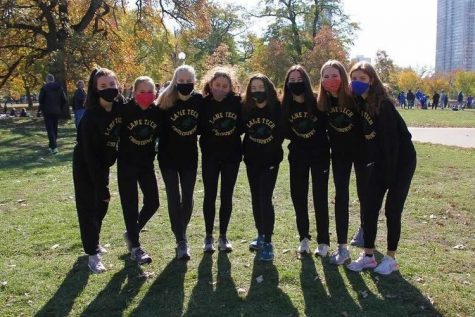 Members of the Lane girls cross country team at the state sectional meet on Oct. 31 at Lincoln Park. The varsity team finished eleventh place at sectionals. (Photo courtesy of Sophia Rivera)