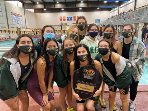 Part of the Lane girls swimming and diving team poses around the city championship plaque after beating Whitney Young to win the team city title. (Photo courtesy of Cece Joshi)