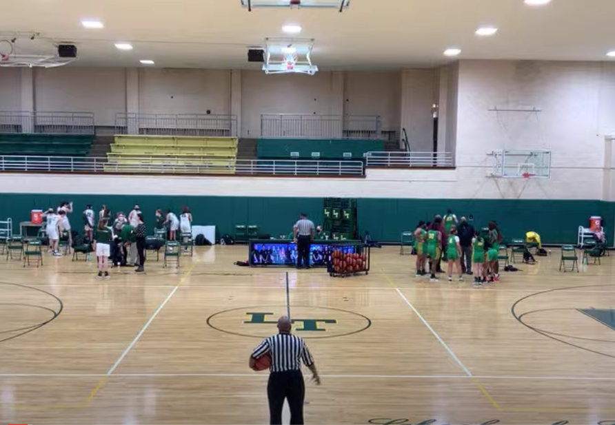 The Lane girls basketball team kicked off their season tonight against Westinghouse at a fan-less Lane gymnasium. (Screenshot from Lane Tech Athletics YouTube broadcast)