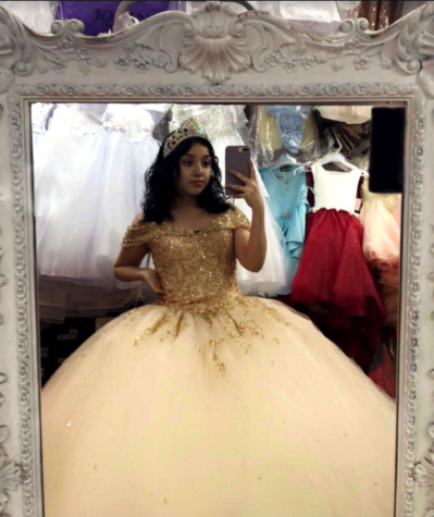 Ariana Medina tried on dresses before the cancellation of her quince in Caritas De Angel boutique, located on West Fullerton Ave in the Belmont Cragin neighborhood. (Photo courtesy of Ariana Medina)