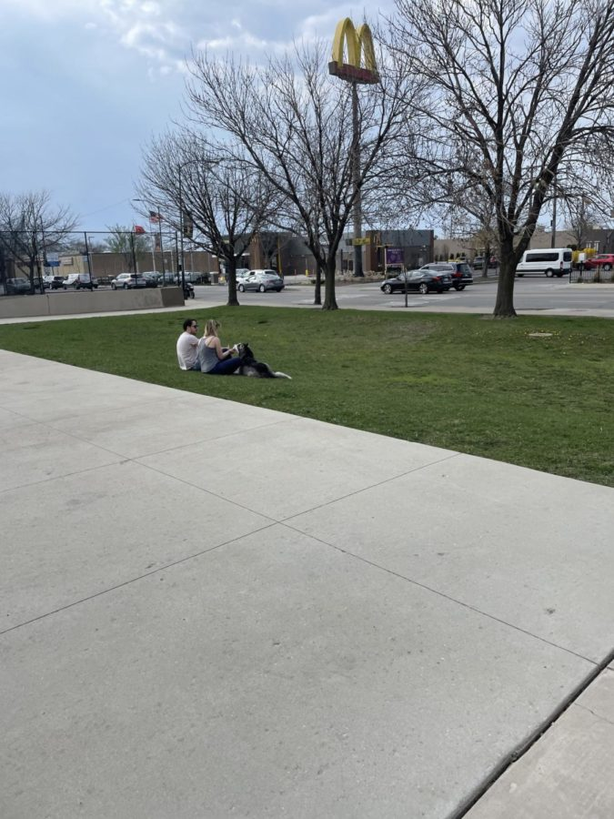 A couple sits outside of Lane Stadium in early April.
