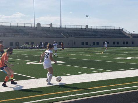 Junior midfielder Scout Murray (#22) receives a pass during Girls Soccer