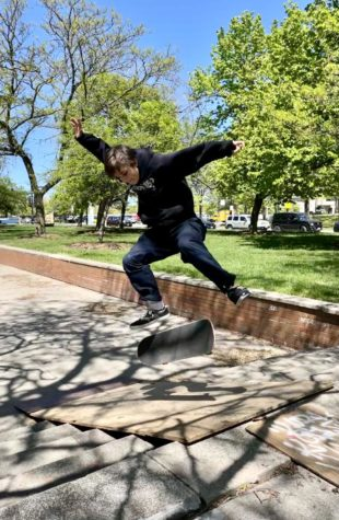 Charlie Hunt pops a textbook kickflip on a ramp made of plywood and other scrap materials brought to Clemente High School.