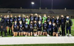 The varsity Lane Girls Soccer team poses with their plaque and medals following their city championship victory on May 27. (Photo courtesy of Head Coach Michelle Vale)