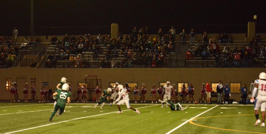 Lane Quarterback Donnell Adams (#8) dropping the ball after being knocked down.