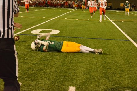 Lanes Payton Gavaldon (#2) lies on the ground after an incomplete pass.