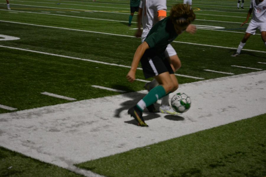 Lane player Henry Winston (#6) fighting for the ball with Dolphin Colin Moran (#8).