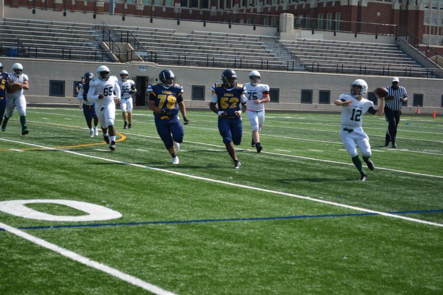 Lane quarterback Mark Seward (#12) readies to throw on the run out of the pocket.