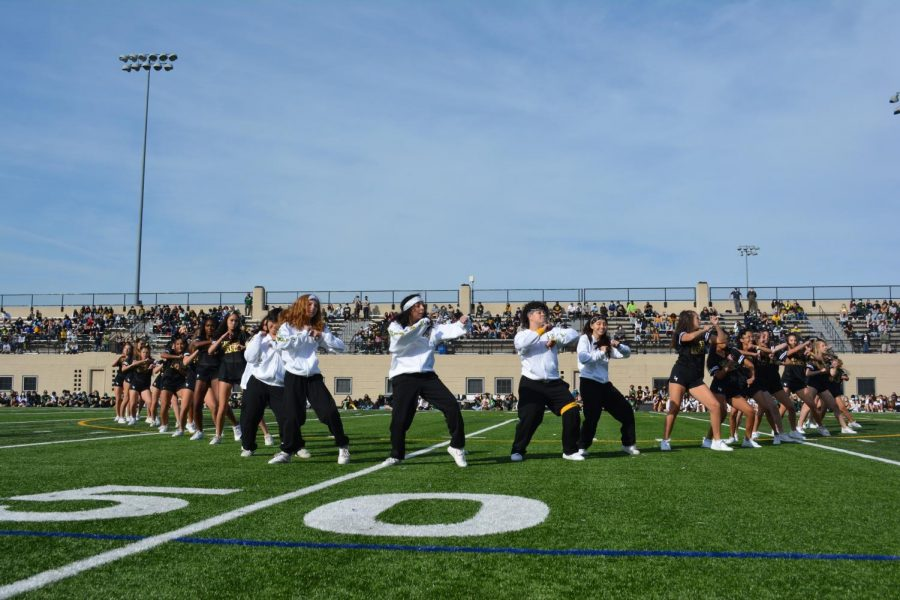The dance team in a v-formation during the pep rally.