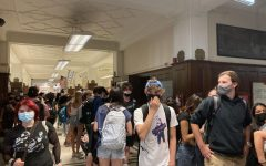 Students wait in the halls of Lane to pick up football tickets after school on Sept. 17.