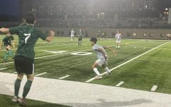 Henry Winston (#6) passing the ball down the field towards (#7) Ryan Hardgrove.