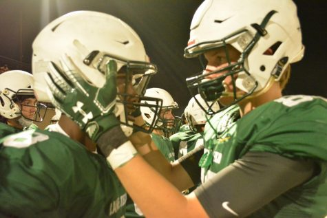 Charlie Duncan (#80) motivates Donnell Adams (#8) before he goes on the field.