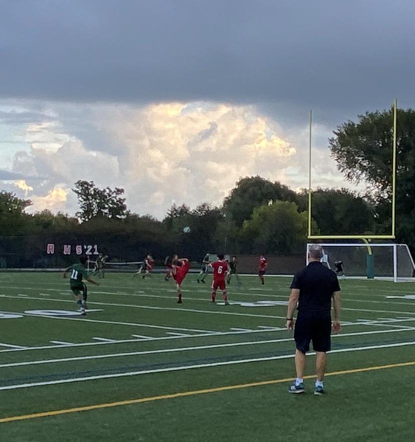 Coach Ricks watches Junior Brando Diaz kick a free kick on Thursday evening.